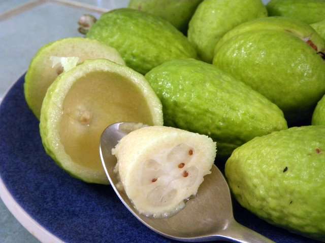 Scoop the fruit of the pineapple guava
