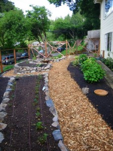 Path divides garden into shade and sun microclimate