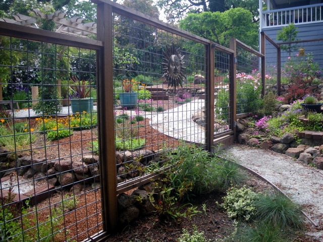 An open fence invites you into the garden