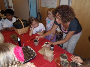 Children learning to sow seed