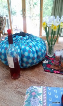 The Wonderbag and wine and flowers, ready for dinner