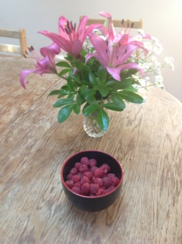 In June we really have beauty and bounty - Raspberries by the bowl and lillies.
